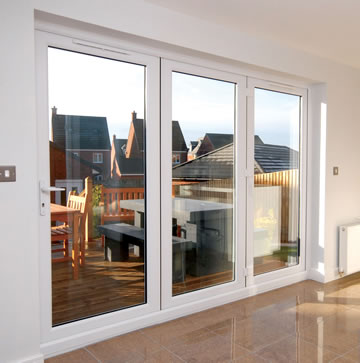 A white PVCu bifolding door